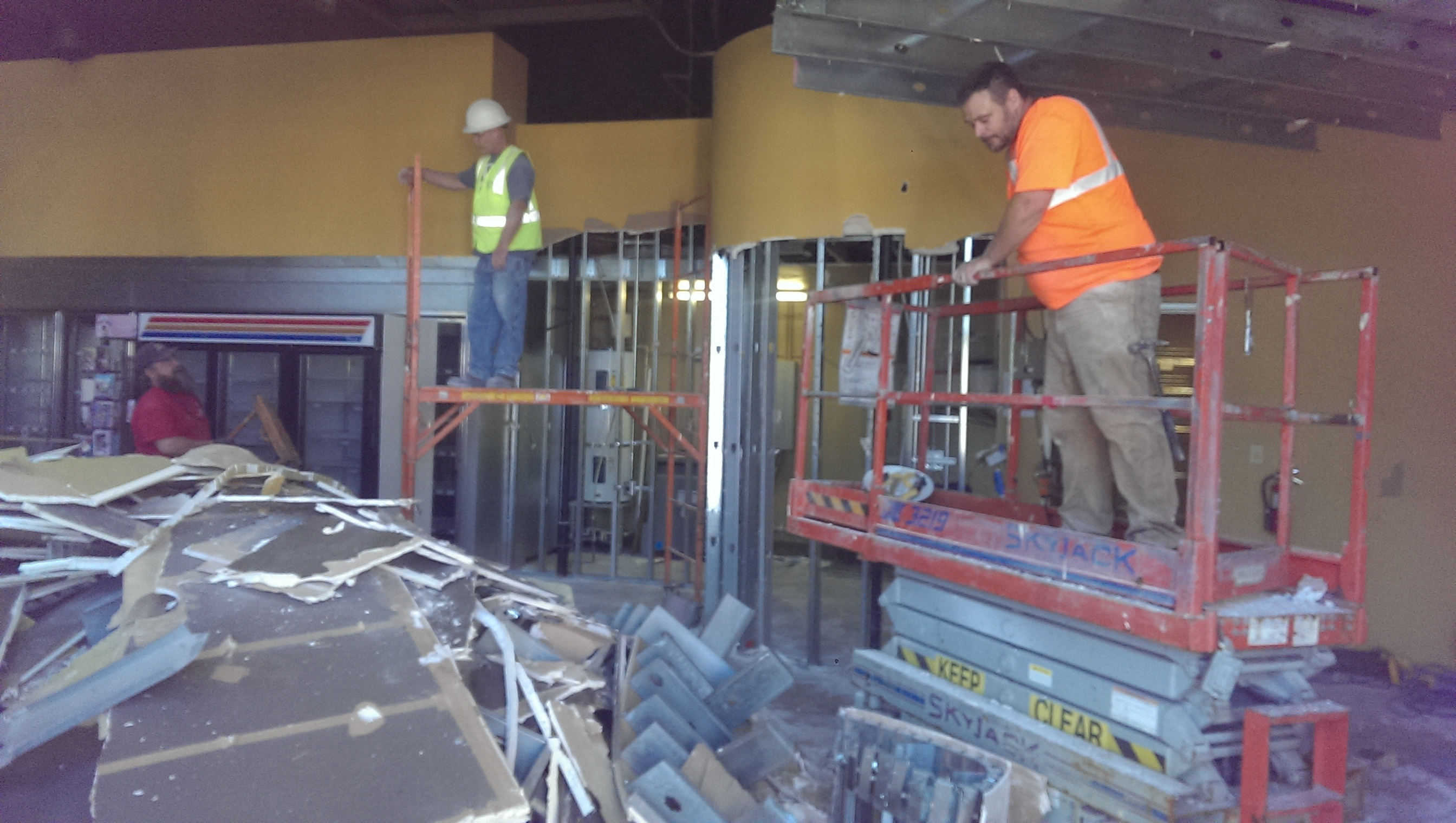 Workers get started at demolition inside The Civic Taproom and Bottle Shop